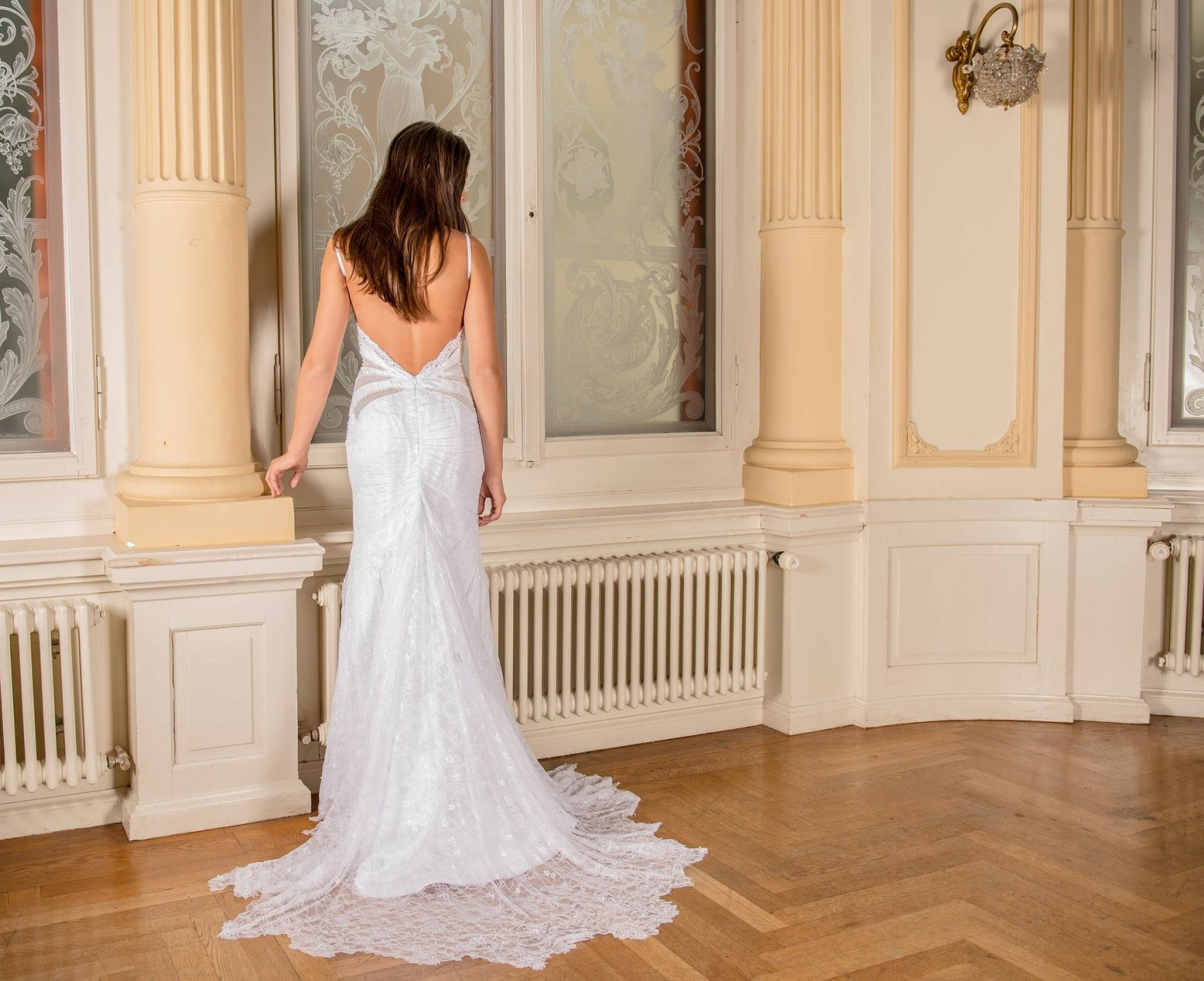 Bride wearing a low cut back wedding dress