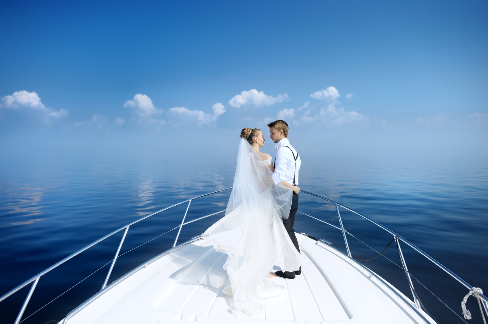 Married couple on yacht in the blue sea